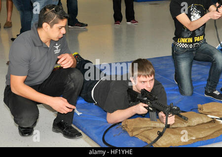 In this image, cadets with the Hutto High School Junior Reserve Officers' Training Corps visit the Round Rock Armed - Stock Photo
