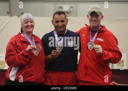 Sgt. Irona Cliver, 33, from Peck, Utah, (left), Gunnery Sgt. John Rojas, 40, from Houston, (center), and Staff Sgt. - Stock Photo