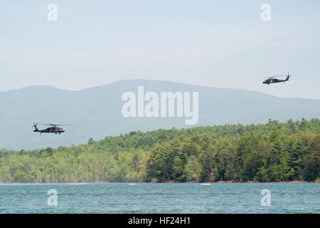 Two North Carolina National Guard Black Hawk Helicopters fly over Lake James in Nebo, N.C., May 7, 2014. The NCNG - Stock Photo