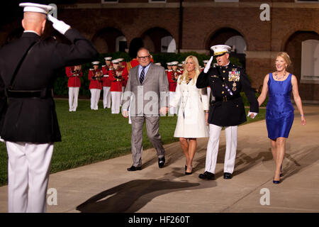 From left, the Evening Parade guest of honor, Bob Parsons; Renee Parsons; the Evening Parade host, Deputy Commandant - Stock Photo