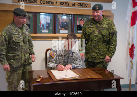 U.S. Army Col. Adam Silvers, director of Army operations, Colorado Army National Guard, is greeted by Canadian armed - Stock Photo
