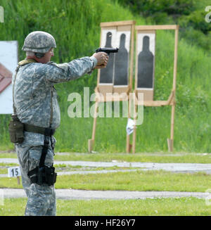 New York Guard Staff Sgt. Joseph Dee fires an M9 pistol during the 35th Annual 'TAG (The Adjutant General) Match - Stock Photo