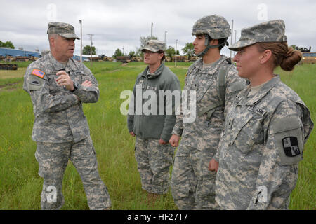 Maj. Gen. Judd H. Lyons, acting director, Army National Guard visits with from (left to right), Staff Sgt. Penelope - Stock Photo