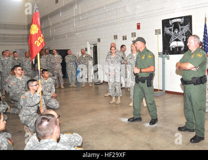 U.S. Customs and Border Protection Agent Tim York addresses Soldiers of the 2220th Transportation Company at the - Stock Photo