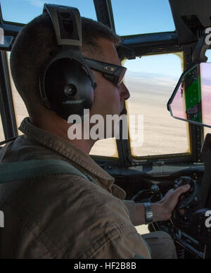 Capt. Luke Roberts, a flight commander with Marine Aerial Refueler Transport Squadron (VMGR) 352 'Raiders,' guides his co-pilot during low-level tactical navigation training with a KC-130J Hercules outside of Yuma, Ariz., July 24. Flight commanders teach pilots and ensure they are mission ready. Raider pilots take low-altitude training head on 140724-M-OB827-022 Stock Photo