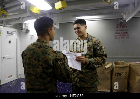 Corporal Daniel Agustin, a landing support specialist with Special Purpose Marine Air Ground Task Force South, and - Stock Photo