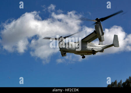A MV-22 Osprey departs from Smith Field while carrying U.S. Marine Corps Col. Matthew G. Trollinger, commanding - Stock Photo