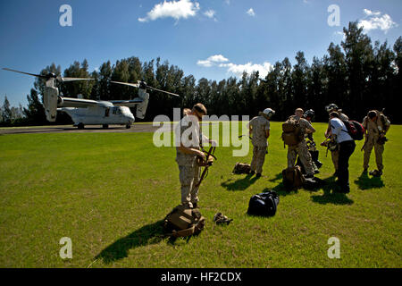 Members of the 11th Marine Expeditionary Unit assemble their life preservers before boarding a MV-22 Osprey on Camp - Stock Photo