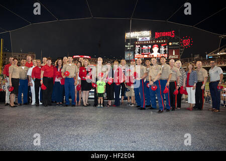 The 35th Commandant of the Marine Corps, Gen. James F. Amos, center, poses for a photo with Marines and other attendees - Stock Photo