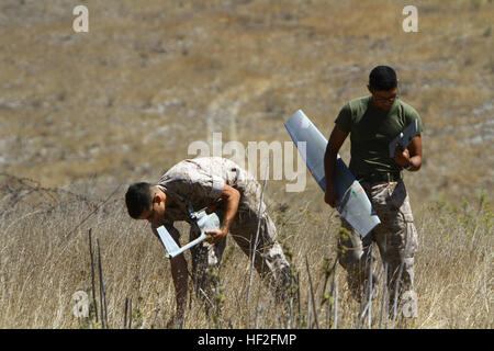 Lance Cpl. Anthony Galvan, 19, and Pfc. Brian Morales, 19, with 2nd Battalion, 5th Marine Regiment retrieve the - Stock Photo