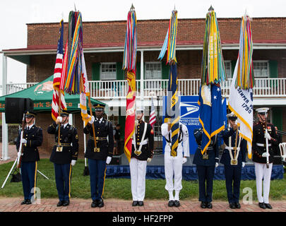 The Maryland Joint Service Color Guard presents the colors during the playing of the National Anthem at a stamp - Stock Photo