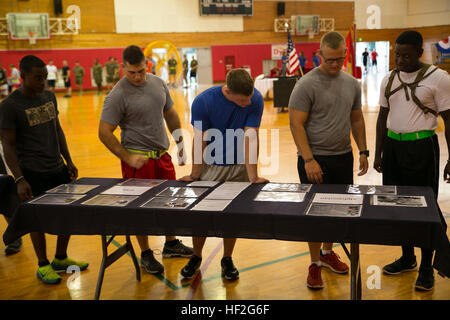 Marines read about missing service members from Operations Enduring Freedom and Iraqi Freedom Sept. 19 prior to - Stock Photo