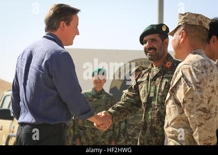 U.K. Prime Minister David Cameron meets with Maj. Gen. Sayed Malouk, commander of Afghanistan's 215th Corps, and - Stock Photo