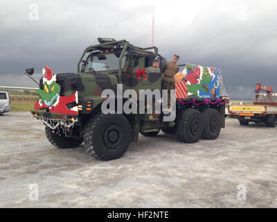 Marines prepare a 7-ton truck as a float during the 2014 Camp Kinser Tree Lighting Ceremony and Holiday parade November - Stock Photo