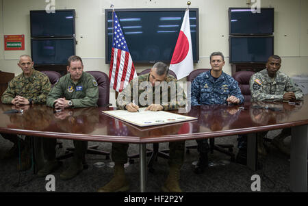 U.S. Marine Lt. Gen. John Wissler, center, signs the Drug and Drunk Driving Prevention Month Proclamation Dec. 4 - Stock Photo