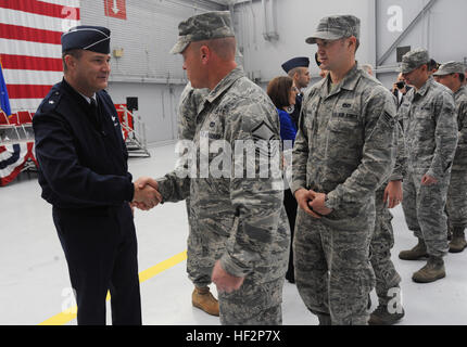 Brig. Gen. Michael Stencel, Oregon Air National Guard commander, left, greets Airmen from the 142nd Fighter Wing Civil Engineer Squadron and Security Forces Squadron after the formal demobilization ceremony at the Portland Air National Guard Base, Ore., Dec. 7, 2014. (U.S. Air National Guard photo by Tech. Sgt. John Hughel, 142nd Fighter Wing Public Affairs/Released) Airmen return from OEF deployment 141207-Z-CH590-242