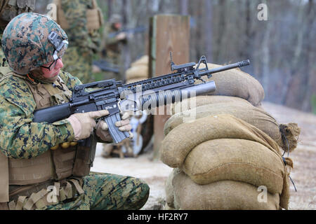 Cpl. Sierra K. Tilson, rifleman with 3rd Platoon, Company A, Ground Combat Element Integrated Task Force, fires - Stock Photo