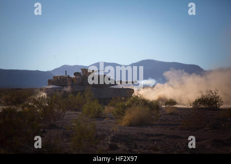 An M1A1 Abram Tank assigned to Delta Company, 1st Tanks Battalion, 1st Marine Division, fires down range as a part - Stock Photo