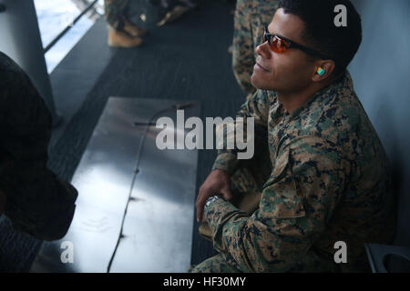 U.S. Marine Staff Sgt. Marques Castro participates in time fuse calculation sustainment training aboard the USS - Stock Photo