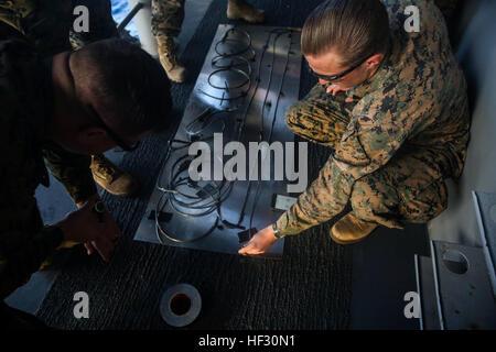 U.S. Marines with the Explosive Ordnance Disposal Detachment, Combat Logistics Battalion 15, 15th Marine Expeditionary - Stock Photo