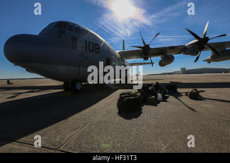 A KC-130J Super Hercules is prepared for a Flight In Support of a Deployed Unit (FISDU) at Marine Corps Air Station - Stock Photo
