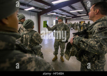 Staff Sgt. Manuel Larranaga Jr., center, briefs Soldiers from 328th Military Police Company, New Jersey Army National - Stock Photo