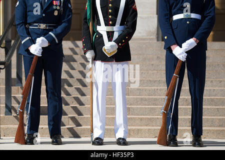 Members of the honor guard stand before the 18th Chairman of the Joint Chiefs of Staff Gen. Martin E. Dempsey greets - Stock Photo