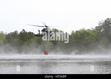 S.C. National Guard Soldiers and Aviators from the 2-151st Security and Support Aviation Battalion use a UH-60 Black - Stock Photo