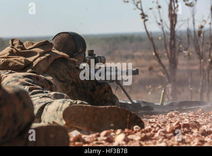 U.S. Marine Corps Cpl. Caleb Lyon shoots the Barrett M82 Special Application Scoped Rifle during Exercise Predator - Stock Photo