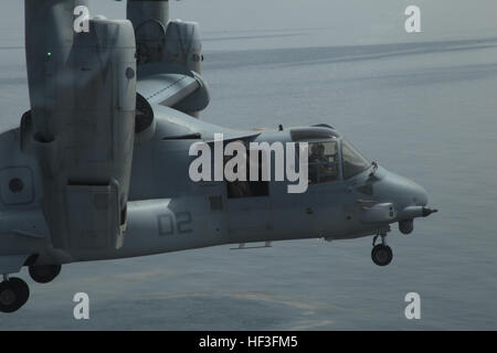 "GULF OF ADEN (July 5, 2015) An MV-22B Osprey from the ""Greyhawks"" of Marine Medium Tiltrotor Squadron 161 (Reinforced), - Stock Photo"