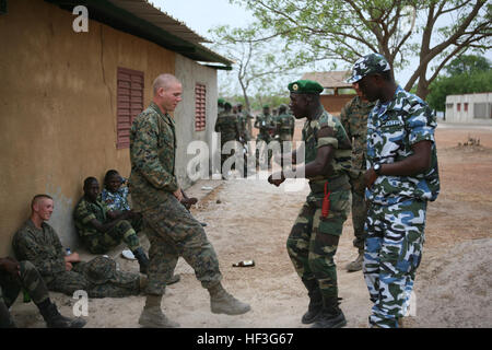 Lance Cpl. Caleb Dehoog mimics Senegalese Marine Commando Mohamed Thaim as he tries to learn a new dance move during - Stock Photo