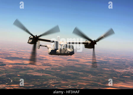 An MV-22B Osprey with Special-Purpose Marine Air-Ground Task Force Crisis Response-Africa flies to the 2015 Gijón - Stock Photo