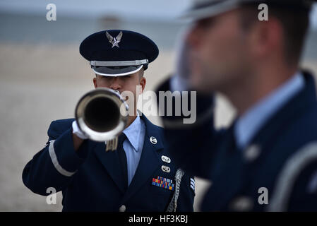 Senior Airman Corey Smith, a member of the 106th Honor Guard, practices with the bugle a few minutes before taking - Stock Photo