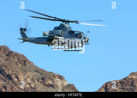 A U.S. Marine Corps AH-1Z Viper assigned to Marine Aviation Weapons and Tactics Squadron One (MAWTS-1) conducts an offensive air support exercise at Mt. Barrow, Chocolate Mountain Aerial Gunnery Range, Calif., Oct. 6, 2015. The exercise is part of Weapons and Tactics Instructor (WTI) 1-16, a seven-week training event hosted by MAWTS-1 cadre. MAWTS-1 provides standardized tactical training and certification of unit instructor qualifications to support Marine Aviation Training and Readiness and assists in developing and employing aviation weapons and tactics. (U.S. Marine Corps photograph by SSg