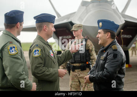 Romanian Air Force Maj. Gen. Laurian Anastasof, center, Chief of the Romanian Air Force Staff, talks with U.S. Air - Stock Photo
