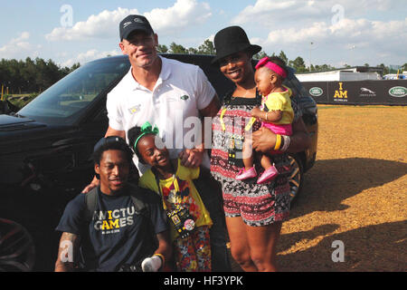 John Cena, center, poses with U.S. Marine Corps veteran Anthony McDaniel and his family during a meet and greet - Stock Photo