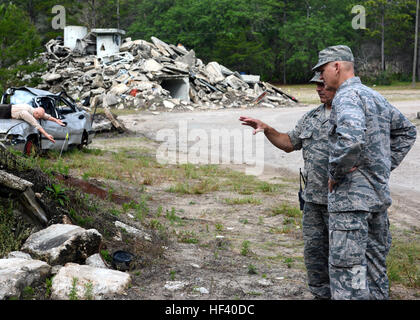 U.S. Air Force Maj. Robert Ard (left) explains the level of complexity in preparation and setup of the Florida Emergency - Stock Photo