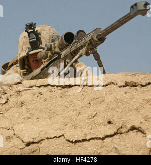 Lance Cpl. Mark Trent, a scout sniper with 3rd Platoon, India Company, 3rd Battalion, 6th Marine Regiment, provides - Stock Photo