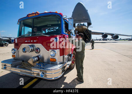 Loadmasters with the 439th Airlift Wing, Air Force Reserve Command, load a 1982 Mack 1250 GPM pumper fire truck - Stock Photo