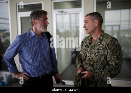 Ambassador Peter Mulrean, the United States ambassador to Haiti, and Rear Adm. Roy Kitchener, commander of Joint - Stock Photo
