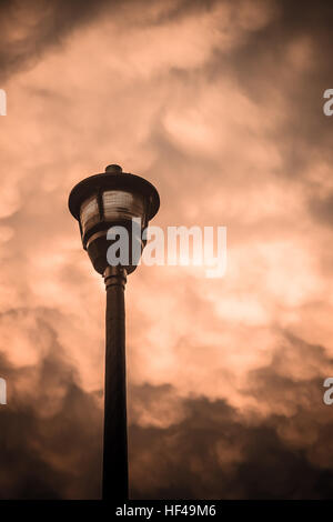 Street lamp against dramatic cloudy sky - Stock Photo