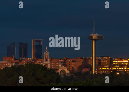 Madrid City skyline seen from Casa de Campo, with the Faro d observation tower and the skyscrapers of Cuatro business - Stock Photo