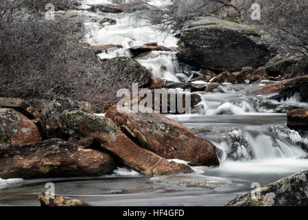 Waterfall, small river on a cold winter day i Norway - Stock Photo