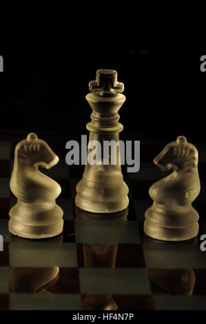 Chess glass pieces on a marble  board - Stock Photo