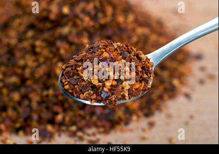 Organic hot red chili flakes made from organically grown whole red chillies - Stock Photo