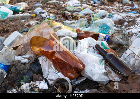 Pile of plastic bags and other refined petroleum products dumped in landfill. Garbage heap gives infiltrate into - Stock Photo