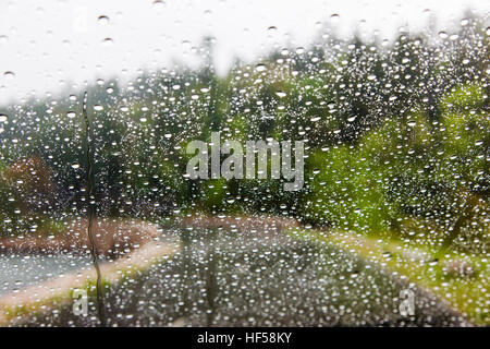 Water droplets on the windshield of an automobile - Stock Photo