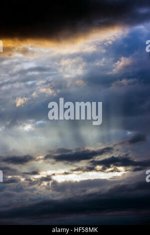 Backlit clouds at sunset - Stock Photo