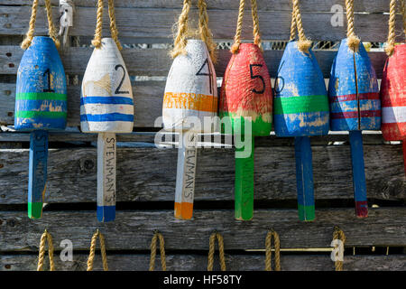 Lobster buoys decorate the Stewman's Downtown restaurant on the city pier; Bar Harbor; Maine; USA - Stock Photo