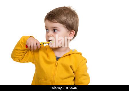 Little Boy Brushing Teeth on white background - Stock Photo